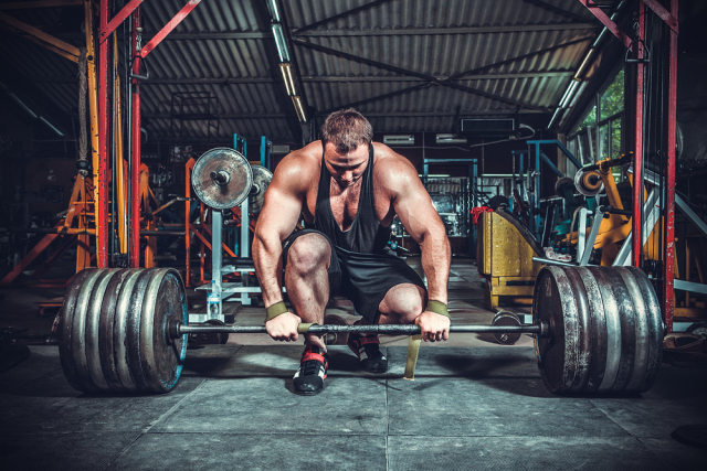 Want To Look Better With Your Shirt Off? Start Training Like A Powerlifter. Seriously.