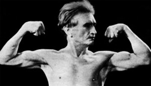 old-bernarr-macfadden-flexing-biceps