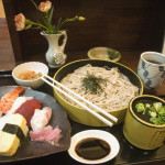 Typical Japanese restaurant lunch: cold buckwheat noodles and sushi seafood favorites eaten with chopsticks, Hiroshima, Japan