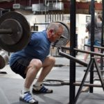 old-man-doing-barbell-squat